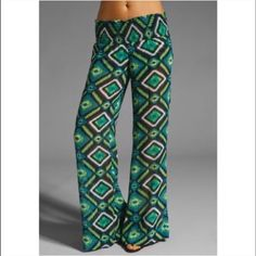 Like New! Show Me Your Mumu Printed Wide Leg Pants Wide leg chiffon like, wide elasticized stretchy waistband, and mix of blue, green, black white. Dry clean, or hand wash/ hang dry. Washed once- never worn. Show Me Your MuMu Pants Wide Leg