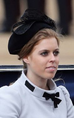 Princess Beatrice travel by carriage along The Mall after the annual Trooping The Colour ceremony at Horse Guards Parade in London