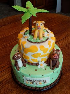 Lion King Baby Shower Cake! 10in and 6in 2 layer rounds, all homemade buttercream icing and candy clay details! candy clay palm tree, baby Simba, Timon and Pumbaa! All edible! https://www.facebook.com/angelas.cakes2011