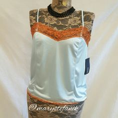 "*NEW NWT* Light Blue Camisole by Hurley size M *NEW NWT* Light Blue Camisole by Hurley size M. This elegant camisole has dark orange lace and is 100% nylon.   Waist: 18.5"" Length: adjustable straps  Please let me know if you have questions. Happy Poshing! Hurley Tops Camisoles"