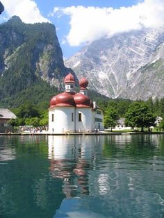 The reflection of St. Bartholomew's Church on Königsee in Berchtesgaden, Germany.