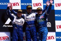 Damon Hill and Jacques Villeneuve celebrate a Williams 1-2, on the podium at the 1996 Canadian GP