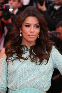 Eva Longoria's icy-blue Versace dress complimented her Chopard jewels perfectly. She wore a pair of white diamond drop earrings and a fancy cut white diamond bracelet of 36.00ct, set in platinum, from Chopard's Red Carpet Collection. #Cannes2013