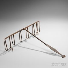 """Wrought Iron Fish Roaster, America, late 18th/early 19th century, the four-footed frame with six hooks and hinged handle marked """"A.L"""" and terminating in ram's-head finial, ht. 24 1/4, wd. 19 1/2, dp. 1 3/4 in."""