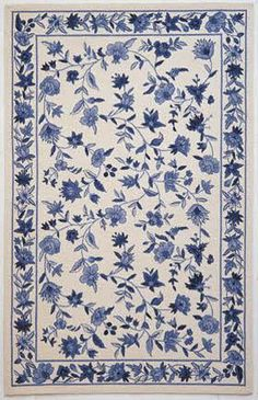 Maybe I should go more traditional with the rug? white and blue china pattern rug