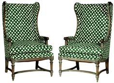 Pair of vintage Baker-style wingback chairs newly upholstered in green designer ikat fabric with down cushions. Seat height: 19""