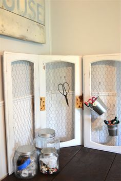 Meridian Road: Old cabinet doors redone with chicken wire and hinged together. Cute