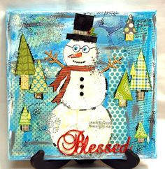 This mixed media Snowman Canvas was created by our own Mimi Dolan Leinbach for Want2Scrap.