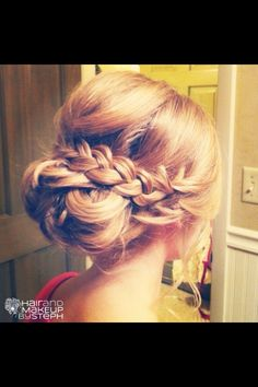 Pretty low bun with braid .. Maybe a little more to the side .. Just a little bit