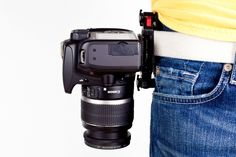 The Capture Camera Clip - Hands-free camera holster for your bag strap or belt. ($79.00, http://photojojo.com/store)