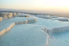 Pamukkale -- 3 hr bus from Seljuk (Ephesus), we'd need to stay overnight so need at least 1 day