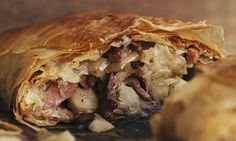 bacon and apple strudel. This is not a strudel in the true sense of the word, because I use readymade filo rather than the traditional strudel. But then I don't have all day. Serves 6. apples 800g, medium sweet or cooking variety lemon juice a little bacon 300g, smoked back or streaky butter 70g breadcrumbs 100g, coarse and fresh filo pastry 6 sheets