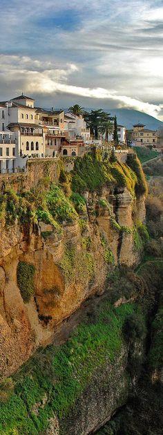 Ronda es una ciudad española perteneciente a la comunidad autónoma de Andalucía, situada en el noroeste de la provincia de Málaga, a unos 100 kilómetros de esta. Es la cabeza del partido judicial homónimo y la capital de la comarca de la Serranía de Ronda.