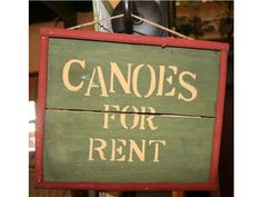 """Wood """"Canoes for Rent"""" Wall Decor"""