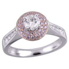 1 ct TW Natural Pink and White diamond Pave Halo Engagement Ring in 14k white and rose gold.