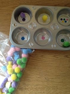 Sort pom poms by color using muffin pan from the dollar store.