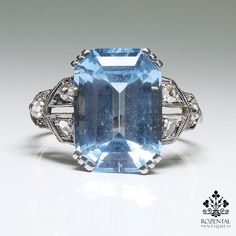 Period: Art deco (1920-1935) Composition: 18K gold and platinum Stones: - 6 Rose cut diamonds of J-SI1 quality that weigh 0.20ctw. - 1 blue topaz that weigh 5ctw. and measures 13mm by 10mm Ring size: