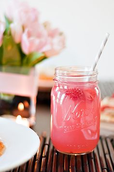 A mix of Corona and raspberry lemonade.