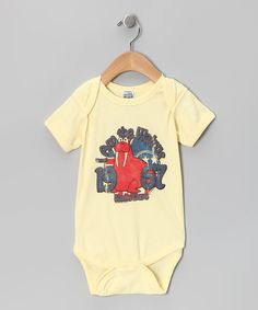 "Made for the coolest of kiddos and parents passing on their great taste, this bodysuit puts the 'rock' in ""Rock-a-bye Baby."" Its super-hip graphic is perfect for showing off on special outings. Even better, its cozy cotton construction feels and looks awesome while dancing around the living room. 100% cottonMachine wash; tumble dry"