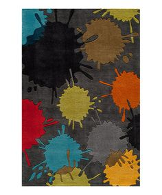 Add a bold splash of personality to any room with this paintball-inspired rug. Ultra hip and edgy, this hand-tufted pick provides a quick and easy way to instantly create a classically cool atmosphere perfect for hanging out in.