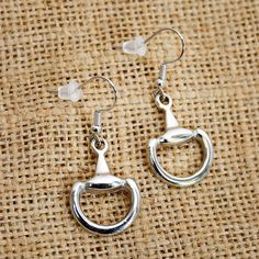 Lilo Collections Half D Bit Earrings feature a shiny silver tone Half D bit hanging from French hooks, these lovely earrings the perfect great gift for any horse lover!