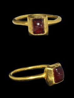 Medieval Gold Cabochon Garnet Ring    14th century AD . A heavy gold finger ring with plain round-section hoop, large rectangular bezel with inset cabochon garnet.