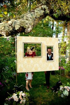instead of a photobooth do a frame with vineyards in the background for guests to take photos in (do one large frame instead of this two picture one)