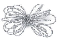 White Diamond 25th Anniversary Bow Pin #jewelry #finejewelry #diamonds #pin #luxury #MartinKatz #MartinKatzJewels