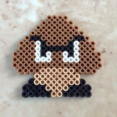 Goomba perler bead sprite  by Jennifer Abraham - https://www.etsy.com/listing/180341894/perler-bead-goomba-sprite