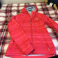 The north face hooded rain coat Super cute rain coat. The moth face HyVent 2.0. In great condition, I love it but it's just too small for me The North Face Jackets & Coats