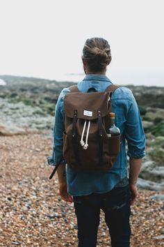 This stunning waxed canvas backpack is built to last. Handmade using a combination of heavy weight waxed canvas and water repellent canvas with heavy duty stitching, robust zips and fastened with brown vegetable tanned leather straps. Simplicity married with form and function.