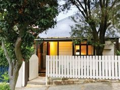 It may look like a simple cottage from the front, but the rear of this Australian home opens up to a surprisingly modern outdoor living space. Modern Outdoor Living, Modern Living, Fence Gate Design, White Picket Fence, Picket Fences, Australia House, Decor Home Living Room, Outdoor Spaces, Outdoor Decor