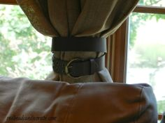 Use a belt to tie back curtains.