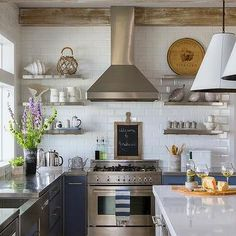 Blue Kitchen Cabinets with Stainless Steel Countertops