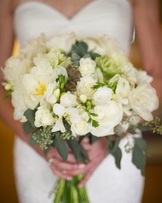Wedding bouquet by Bliss: an organic blend of eucalyptus, succulents, roses, and freesia