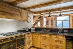 La Grange au Merle is a newly refurbished luxury chalet by Clarian Chalets. Alpine Chalet, Ski Chalet, Underfloor Heating, Old Wood, Wood Paneling, Catering, Skiing, Kitchen Cabinets, Relax