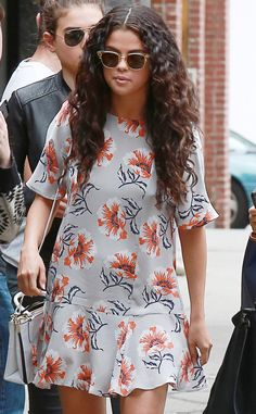 Selena Gomez got into the summery spirit with a fun floral frock and sunnies with a soft yellow crystal finish!