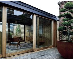 glass sliding doors - could this be an option for us. Like the weather timber look