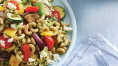 Roasted Vegetables & Goat Cheese Pasta Salad | This go-to pasta salad is hearty and delicious served cold (but great warm, too!). If your kitchen is getting a bit too stuffy for your liking, head outdoors and take this recipe with you: You can also make the whole thing outside on your grill!