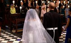 Meghan Markle curtsies to the Queen at the royal wedding - see video from inside St George's Chapel