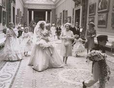 Princess Diana carries Hambro alongside Queen Elizabeth; Princess Margaret's daughter, Sarah Armstrong Jones, walks behind them.