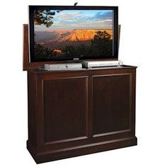 Carousel TV Lift Cabinet with manual swivel. Finished on all 4 sides. Made by Amish craftsmen.