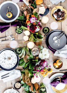 Overflowing with lush floral centerpieces, this rustic-chic tabletop featured on Green Wedding Shoes incorporates traditional fall colors and sophisticated glassware into one seriously stunning Thanksgiving tablescape.