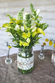 lace wrapped mason jar centerpiece and some wild flowers makes a great rustic table scene Spring Flower Arrangements, Spring Flowers, Wild Flowers, Canning Jar Centerpieces, Pickle Jars, Wedding Inspiration, Wedding Ideas, Rustic Table, Wedding Wishes