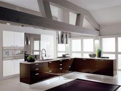 brown modern open kitchen with brown backsplash and white cabinet storage