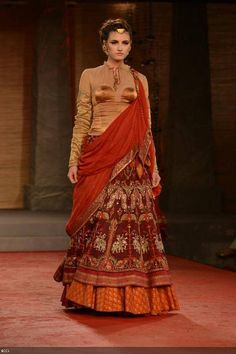A model showcases a creation by designer Anju Modi on Day 1 of Delhi Couture Week, held in New Delhi, on July 31, 2013.