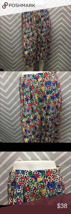 Gorgeous vintage maxi floral skirt Perfect condition. Adorable vintage floral skirt with black polka dots. 28 inch stretch waist. 30 inch length Skirts Maxi