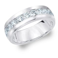 With its classic design, this dashing diamond band communicates a distinguished simplicity making it a perfect pick for any gentleman. This magnificent wedding band features round brilliant cut diamonds to surround the entire ring. The diamonds are secured by an exquisitely crafted and sleek channel setting. Each diamond is hand selected to guarantee a perfect match for its mates, and machine set to guarantee precision and a perfect setting.