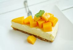Pureed fresh mango gives this cheesecake a light and soft texture and subtle tropical fruit flavor.