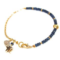 """This deep blue sapphire bracelet features a sparkling gold star charm and a lovely labradorite  dangle.  This bracelet has a lobster clasp and measures approximately 6 3/4"""" with a gold vermeil chain.  **This listing is for one bracelet as seen in photos 1,2 and 5.**  Wear a sparkling stack of fabulous gemstones in a rainbow of colors or just one - you decide!  xoxoxo payton  For more cool jewelry looks, check out http://www.etsy.com/shop/FizzCandy  All FizzCandy creations come beautifull..."""